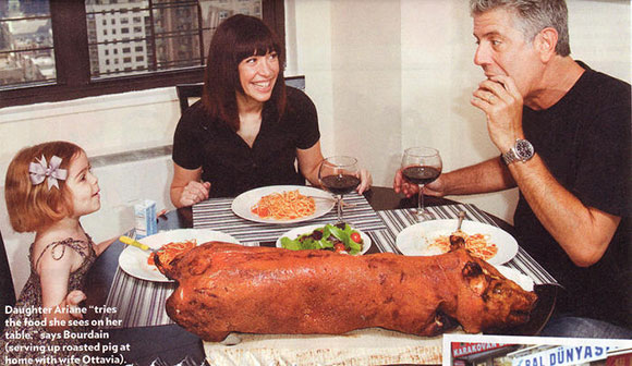 Anthony Bourdain with wife Ottavia Busia and daughter Ariane having a roasted pig at home