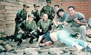 Members of Search Bloc celebrate over Escobar's body on 2 December 1993.